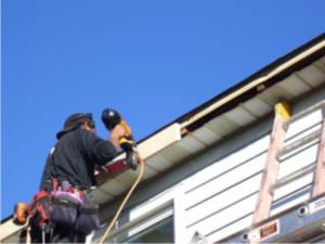 Picture of gutter installer Installing new fascia wood