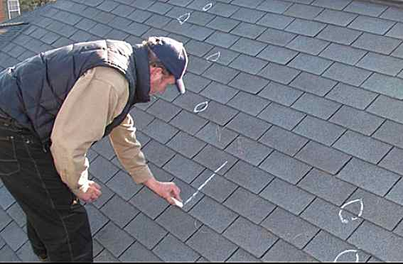 Inspector looking at roof