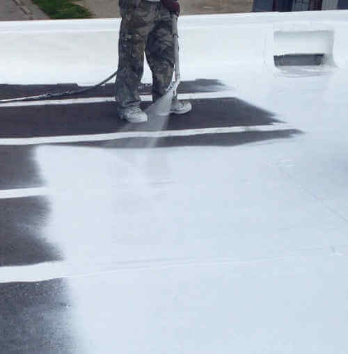 coating being applied to a flat roof
