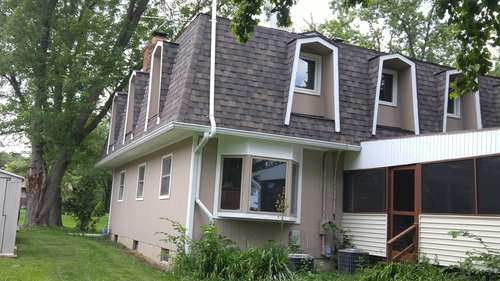 cary roofers who do mansard roofs